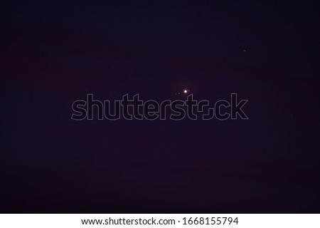 Jupiter and moons of Jupiter—Callisto-Ganymed-Io-(Jupiter)-Europa  in the night sky.