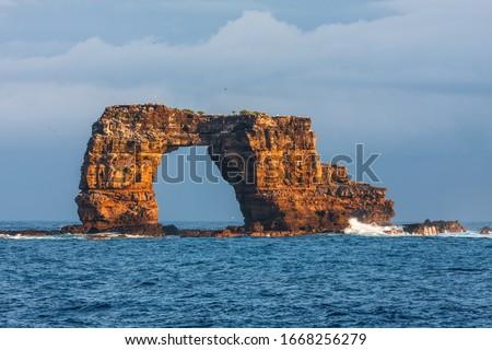 Famous Darwin's Arch in Galapagos in Ecuador Royalty-Free Stock Photo #1668256279