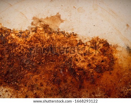 Yellow brown rust and dirt on white enamel. Rusted brown and white abstract texture. Corroded white metal background. Rusty white painted metal wall. #1668293122