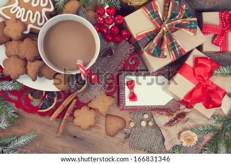 Gingerbread cookies and cup of coffee with christmas decoration #166831346