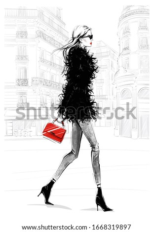 Hand drawn beautiful young woman with bag. Fashion look. Stylish girl walking with Paris street background. Woman in black feather jacket. Sketch. Fashion illustration.