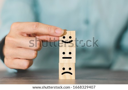 Customer choose smiley face on wood cube block, Business service rating , Satisfaction concept #1668329407