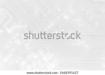 White texture background of printed circuit board. Computer technology background. Information tech. Space for text. Gray scale pcb background. Royalty-Free Stock Photo #1668391627