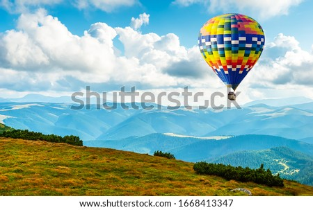 Amazing view of mountains with colorful hot air balloon. Travel concept. Artistic picture. Beauty world.