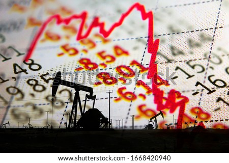Stock market declining chart and oil pump jack - abstract background Royalty-Free Stock Photo #1668420940