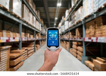 Smart device warehouse scan and go. Smart scan that allows customers to Smart scan products and items from the shelves concept #1668431614