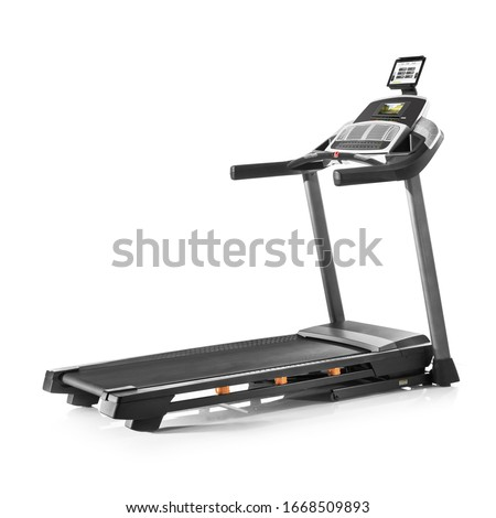 Treadmill Isolated on White Background. Sports and Fitness Exercise Equipment. Side View of Modern Black Gym Trainer Treadmill with LCD Display and Incline Control Tread Belt. Powerhouse Machine #1668509893