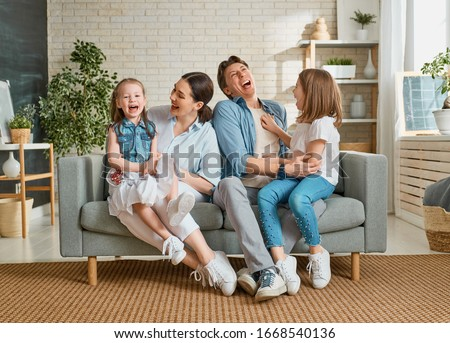 Happy family! Two children daughters with mother and father. Mum, dad and girls laughing and hugging.  #1668540136