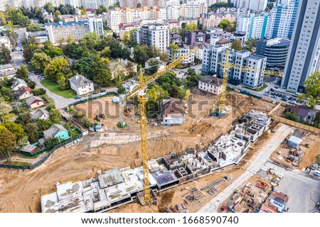 aerial panoramic view of urban area with construction site. new apartment building under construction. birds eye view