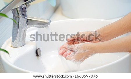 Hygiene concept Wash your hands with soap in the sink.Cover for virus protection. #1668597976