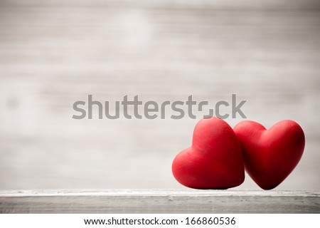 Red heart on the wooden  background.