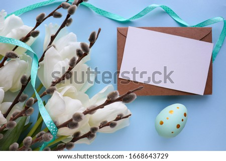 Easter card design. spring composition. sprigs of willow, tulips, irises and an Easter egg. space for text #1668643729