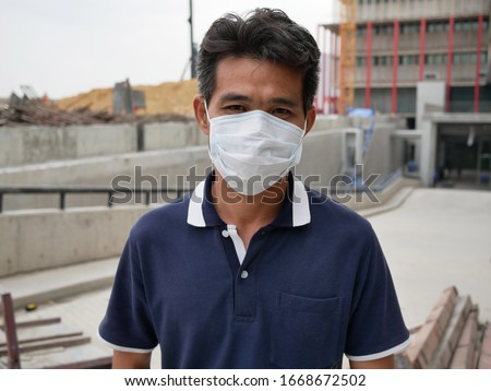 asian man wearing medical mask with outdoor. #1668672502