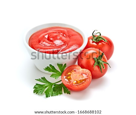 Fresh, organic tomato puree, isolated on white. Tomato cherry sauce in bowl, cooking concept. Healthy vitamin vegetables, vegan diet food condiment. Raw tasty cherry ketchup. Royalty-Free Stock Photo #1668688102