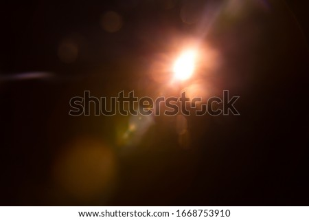 Abstract Natural Sun flare on the black Royalty-Free Stock Photo #1668753910