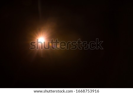 Abstract Natural Sun flare on the black Royalty-Free Stock Photo #1668753916
