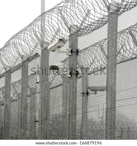 surveillance cameras on prison wall #166879196