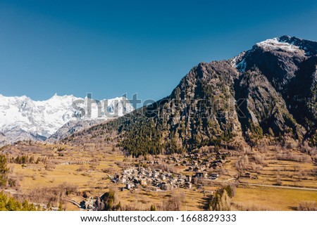 The village Palleusieux under a big mountain, in the Basin Pre-Saint-Didier, Aosta Valley, Italy #1668829333