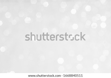 Abstract background with a white light blur .