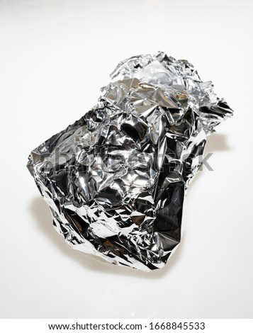 Close Up of Crumpled Aluminum Foil Isolated on White Background #1668845533