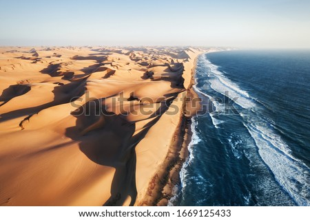 Place where Namib desert and the Atlantic ocean meets, Skeleton coast, South Africa, Namibia, aerial shot #1669125433