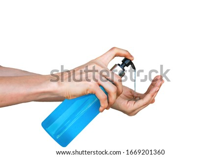Asian women using hands Press the pump on the hand sanitizer bottle which contains alcohol. Until causing the blue gel to flow out To destroy all types of viruses at hand With white background #1669201360