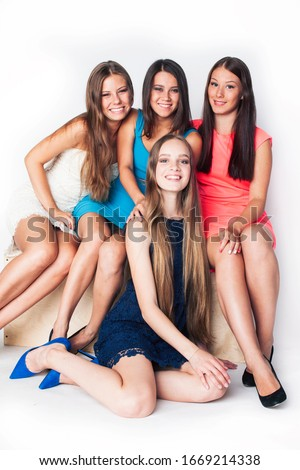 many girlfriends hugging celebration on white background, smiling talking chat closeup, lifestyle people concept #1669214338