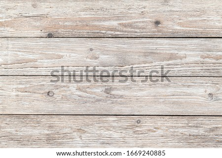 Vintage light wood background texture with knots. #1669240885