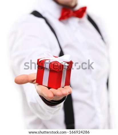 Man gives a present wrapped in red gift paper, isolated on white  #166924286