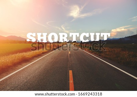Shortcut behind the tree of empty asphalt road at golden sunset and beautiful blue sky. Concept for the way of success. Royalty-Free Stock Photo #1669243318