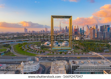 Aerial view of Dubai Frame, Downtown skyline, United Arab Emirates or UAE. Financial district and business area in smart urban city. Skyscraper and high-rise buildings at sunset. #1669247047