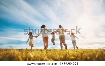 Happy family on summer walk! Mother, father and daughters walking in the Park and enjoying the beautiful nature.                                #1669254991