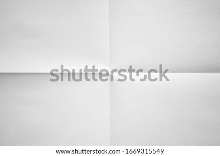White paper folded in four fraction background #1669315549