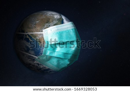 Planet Earth with face mask protect. World medical concept. Elements of this image furnished by NASA. #1669328053