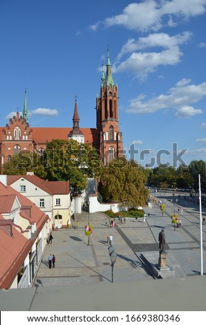 Old church in the city center. Beautiful view on the church with high pics. Blue sky above church. The Cathedral Basilica of the Assumption of the Blessed Virgin Mary. Roman Catholic cathedral.