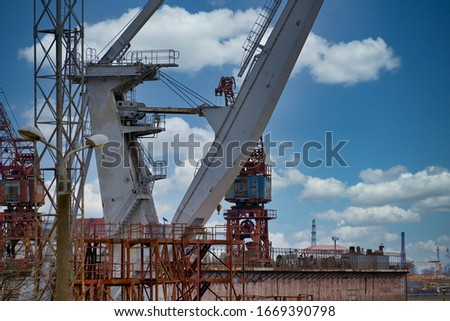 Close up shot of a crane at a harbour. Royalty-Free Stock Photo #1669390798