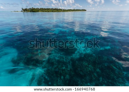 Tropical island lifts out of  coral reef in Hol Chan Marine Reserve Belize Royalty-Free Stock Photo #166940768