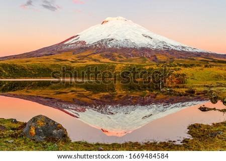 cotopaxi volcano reflecting in santo domingo laguna #1669484584