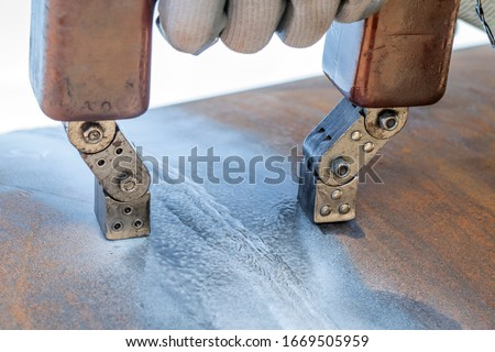 Magnetic particle testing. It is a non destructive testing (NDT) process. The principle of the method is that the specimen is magnetised to produce magnetic lines of force, or flux, in the material. Royalty-Free Stock Photo #1669505959