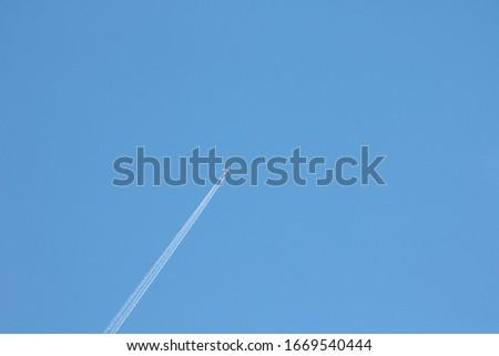 blue sky, jet cross the picture, copyspace