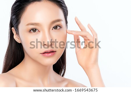 Beautiful Young Asian Woman with Clean Fresh Skin. Face care, Facial treatment, Cosmetology, beauty and healthy skin and cosmetic concept .woman beauty skin isolated on white background. #1669543675