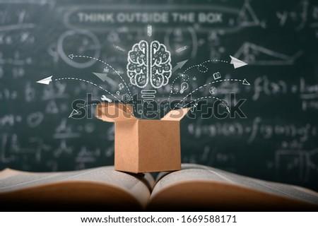 think outside the box on school green blackboard . startup  education concept. creative idea. leadership.