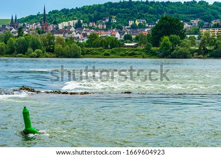 Germany, Rhine River Romantic Cruise, a body of water with a city in the background #1669604923