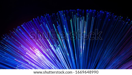 fiber optics network cable for fast communications Royalty-Free Stock Photo #1669648990