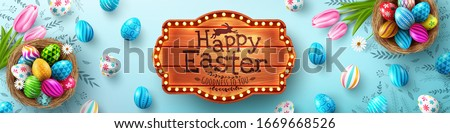 Easter poster and banner template with Easter eggs in the nest on light blue background.Greetings and presents for Easter Day in flat lay styling.Promotion and shopping template for Easter #1669668526