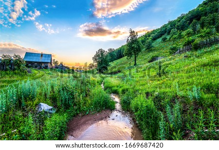 Summer rural river creek landscape. Sunrise rural river creek view. Rural creek in sunrise scene. Sunrise rural creek landscape #1669687420