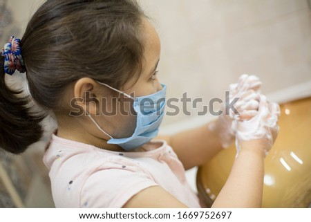 Pretty little asian kazakh girl in mask washing her hands. Person, Man, woman in mask. #1669752697