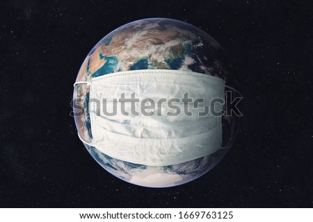 Earth planet in medicine mask to fight against Corona virus. Concept of fight against epidemic and climate change. Pollution of the planet by exhaust gases. Elements of this image furnished by NASA #1669763125