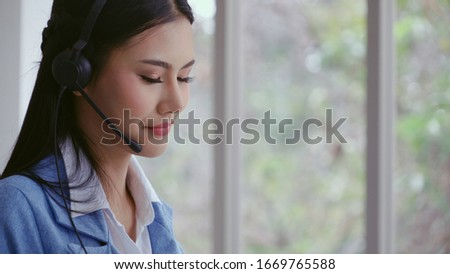 Customer support agent or call center with headset works on desktop computer while supporting the customer on phone call. Operator service business representative concept. #1669765588