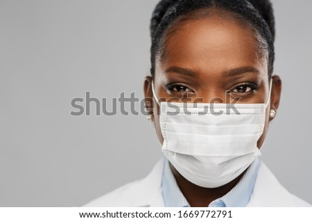 medicine, profession and healthcare concept - close up of african american female doctor or scientist in protective facial mask over grey background #1669772791